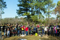 Apache Corp employees plant trees and participate in the City of Houston's Annual Arbor Day Celebration.